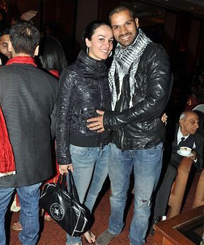 Shikhar-Dhawan-and-his-fiancee-Esha-during-the-wedding-of-Yashpal-Sharmas-daughter-Puja-at-Eros-Hilton-Hotel-in-Delhi-on-January-19-2012-
