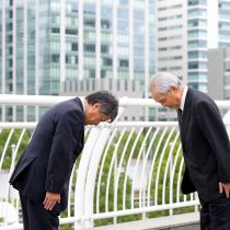 men-bowing-in-japan-a49a96e99f0f4f64a524c7f449ca77cc
